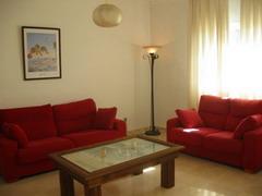 20061106101528-sofas-rozados.jpg
